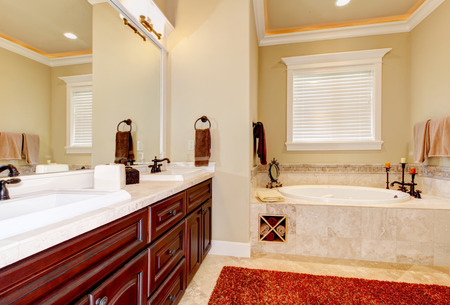 Master bathroom interior with cherrywood cabinets, double sink and gorgeous bathtub. Northwest, USA