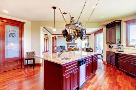 mahogany: Luxury modern kitchen room with mahogany storage combination, granite tops, island and hanging pot rack. Northwest,USA.