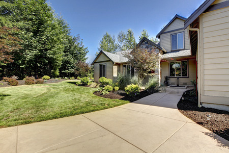 walkway: Exterior of American two story house with concrete walkway and nice landscape design around. Northwest, USA