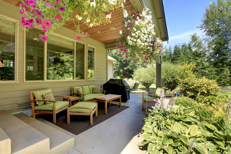 northwest: Cozy backyard concrete floor patio area with table set. Northwest, USA