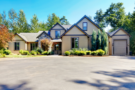 curb appeal: Curb appeal of luxury two story hose with garage and concrete driveway.. Northwest, USA