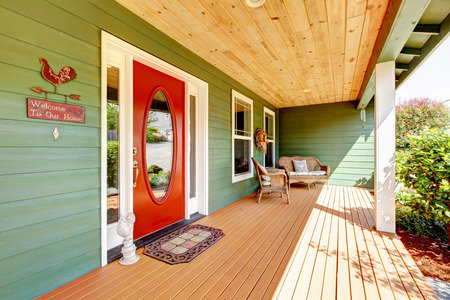 northwest: Spacious entrance porch with red door and wooden chair. Northwest, USA
