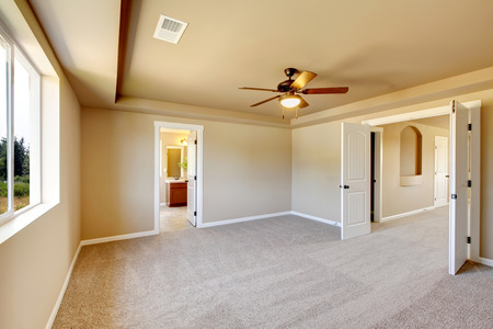 remodeled: Bright beige empty room interior with carpet floor. View of bathroom. Northwest,USA
