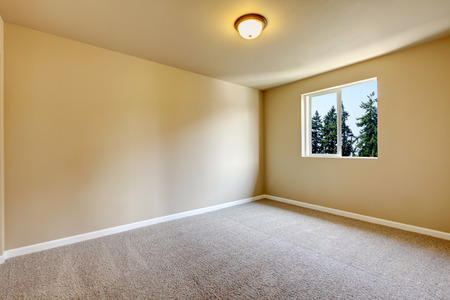 remodeled: Bright empty room with one window, light gray carpet floor and beige walls. Northwest, USA