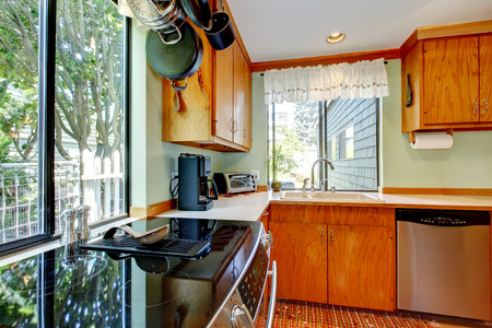 appliances: Bright kitchen with light brown cabinets, steel appliances and wooden counter tops. Norhtwest , USA