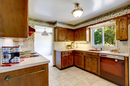 old furniture: Empty simple old kitchen with tile flooring and vintage cabinets in American rambler. Northwest, USA