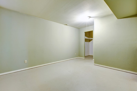 rambler: Empty basement room in ivory color with pantry in American rambler house. Northwest,USA Stock Photo