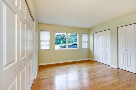 sliding doors: Empty room interior with hardwood floor and three closets with white sliding doors. Northwest, USA
