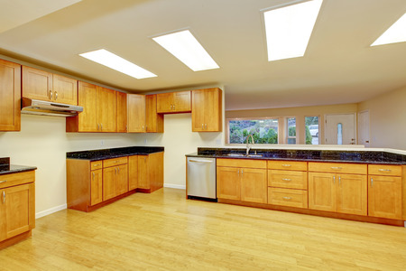 skylights: Spacious kitchen room with light brown cabinets and black granite counter tops. Also ceiling with skylights. Norhtwest, USA