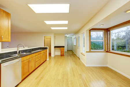 skylights: Spacious kitchen room with light brown cabinets and black granite counter tops. Also ceiling with three skylights. Norhtwest, USA