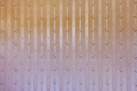 wallpaper floral: Vintage beige striped wallpaper with floral pattern. Stock Photo