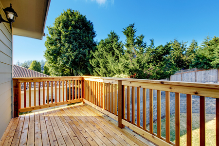 unfurnished: Unfurnished small walkout deck with backyard view. Northwest, USA Stock Photo
