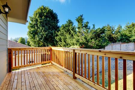 northwest: Unfurnished small walkout deck with backyard view. Northwest, USA Stock Photo