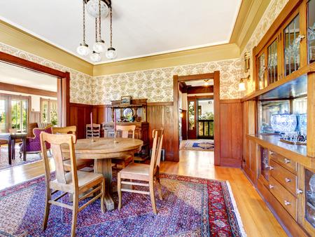 pannel: Open floor plan antique dining area with wooden pannel trim and hardwood floor. Northwest, USA