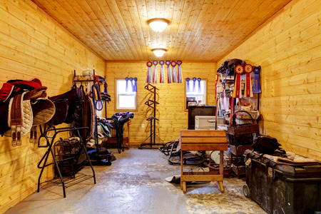 new construction: Beautiful clean stable horse barn. Storage room with horse racing equipment. Northwest, USA