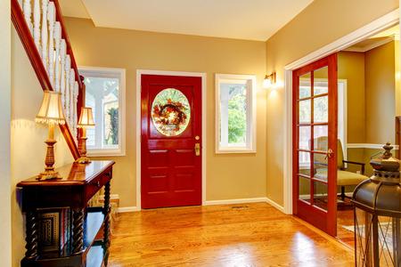 entryway: Horse ranch entryway with red door and hardwood floor. Northwest, USA