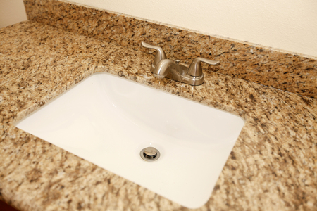 Close up of the bathroom sink and granite counter top. Northwest, USA