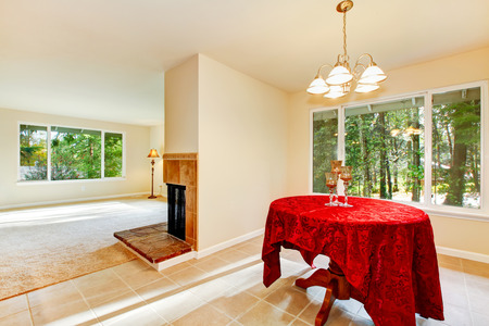 floor cloth: Tile floor dining room interior with elegant red table cloth. The room is connected with empty living room. Northwest, USA