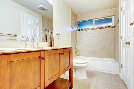 tile flooring: White bathroom interior with tile wall  trim and tile flooring. Northwest, USA Stock Photo