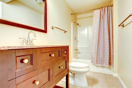 remodeled: Nice remodeled bathroom interior with tile floor, vanity cabinet with drawers and cute shower curtain. Northwest, USA