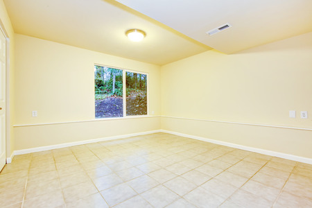 tile flooring: Bright creamy tones empty room with tile flooring and a window.