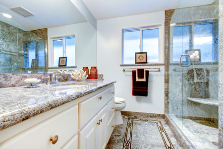 marble flooring: Amazing bathroom with marble flooring and marble wall trim in shower cabin. Northwest, USA