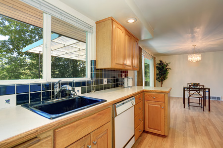 Kitchen room interior with cabinets and blue tile back splash trim. Northwest, USA