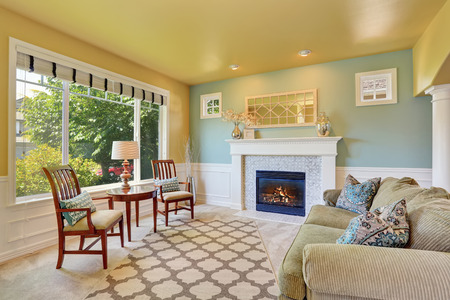yellow walls: Elegant living room interior with yellow ceiling and mint walls. Northwest, USA