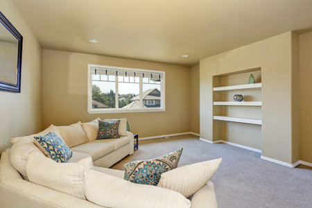 Cozy sitting room with large beige corner sofa set. Northwest, USA