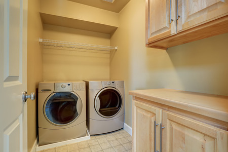 dryer  estate: Beige laundry with modern appliances and tile floor. Northwest, USA