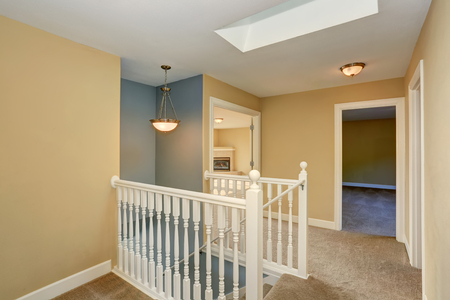 residential building: Hallway interior with carpet floor and staircase. Northwest, USA Stock Photo