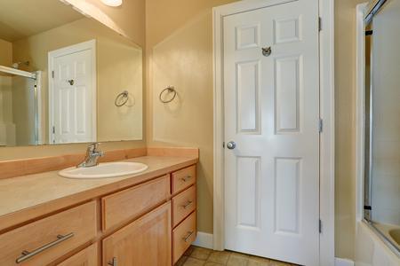 bathroom tile: Bathroom interior with modern cabinets and tile floor. Northwest, USA Stock Photo