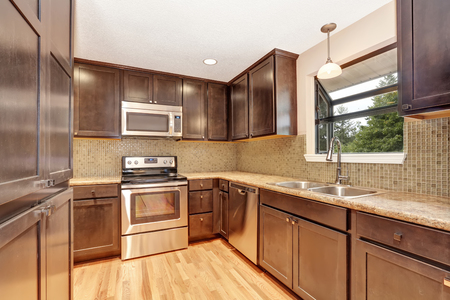 northwest: Kitchen interior with brown cabinets and granite tops. Northwest, USA