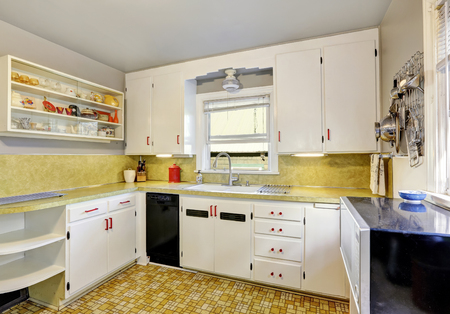cabinets: Old fashioned kitchen with white cabinets, cupboard and  linoleum floor. Northwest, USA Stock Photo