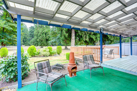 fire pit: Covered back deck with outdoor seats and clay fire pit. Northwest, USA