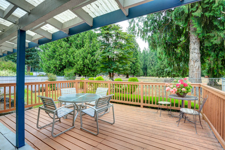View of walkout deck with Patio furniture. House exterior in Tacoma. Northwest, USA Stock Photo