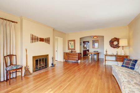 Spacious living room interior with large sofa and fireplace. Shiny hardwood floor. Northwest, USA Stock Photo