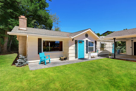 rambler: American rambler exterior with covered deck and well kept lawn. Bright blue entrance door. Northwest, USA