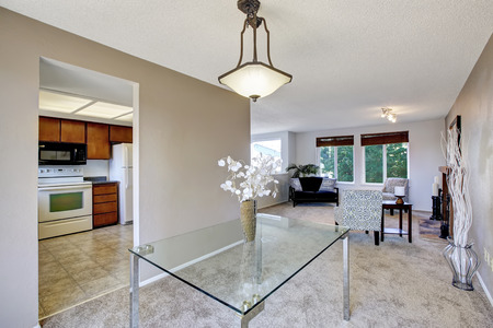 Elegant bright dining area with glass table and nice decor. Exit to the balcony. Northwest, USA