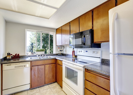 northwest: Small and simple kitchen interior with white appliances. Northwest, USA Stock Photo