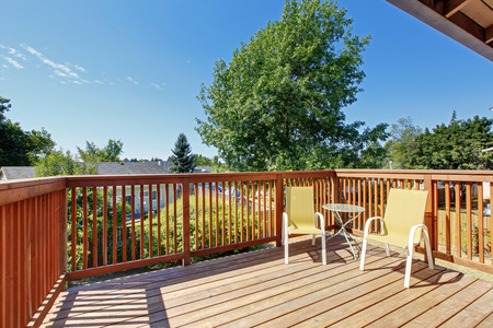 Small balcony with two chairs overlooking nice view. Northwest, USA