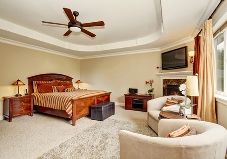 king size: Master bedroom interior with corner fireplace and king size wooden bed. Northwest, USA