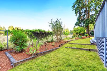northwest: Backyard garden with green grass. House exterior. Northwest, USA