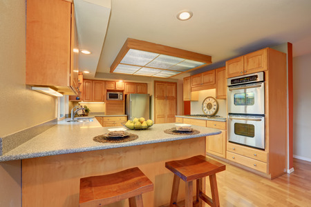 skylight: Bright wooden kitchen interior with skylight and steel appliances. Northwest, USA