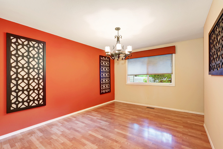 interior wall: Empty room interior with latticework decor on a red contrast wall.  Northwest, USA Stock Photo