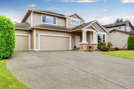 driveways: Neat beige home with two garage spaces and large concrete driveway. Northwest, USA
