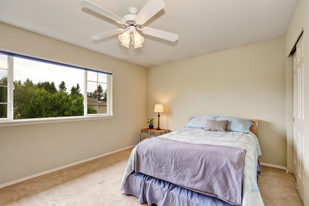 furnished: Bedroom interior in pastel blue and beige color. There is also a built-in closet, large window and carpet floor. Northwest, USA