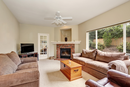 Cozy Elegant Family Room With Backyard View. Furnished With Brown Velvet  Sofa Set, Corner