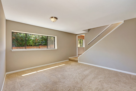 empty room: Empty beige room with staircase, large window and carpet floor. Northwest, USA
