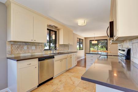 tile flooring: Kitchen interior with tile back splash trim and tile flooring. Northwest, USA Stock Photo